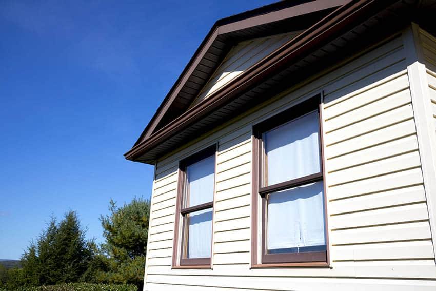 Brown fiberglass windows on house