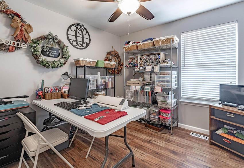 Budget craft room with folding table metal storage racks