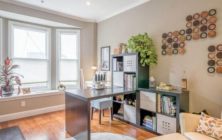 Contemporary crafts room with desk for scrap booking and bay window