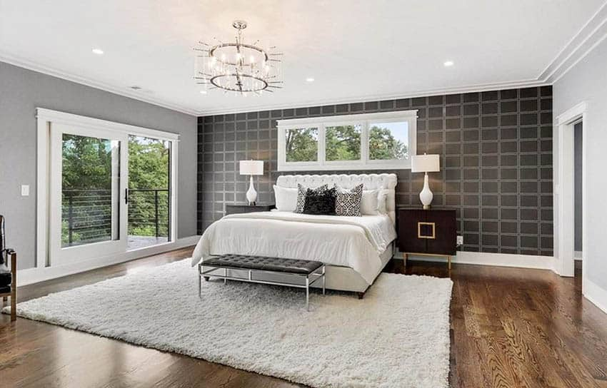 Contemporary master bedroom with cal king bed black silver accent wall
