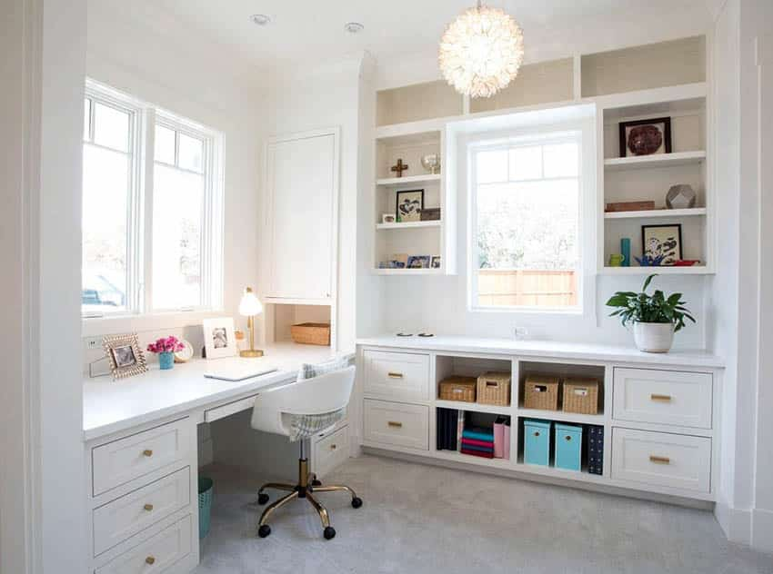 Craft room with built in bookshelves and desk