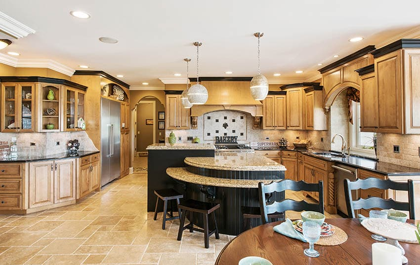 Expansive kitchen with raised panel cabinets large multi level island beige granite countertops