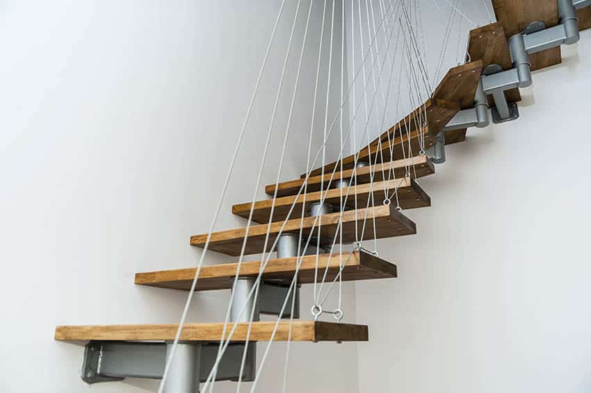 Floating wood stairs with cable supports