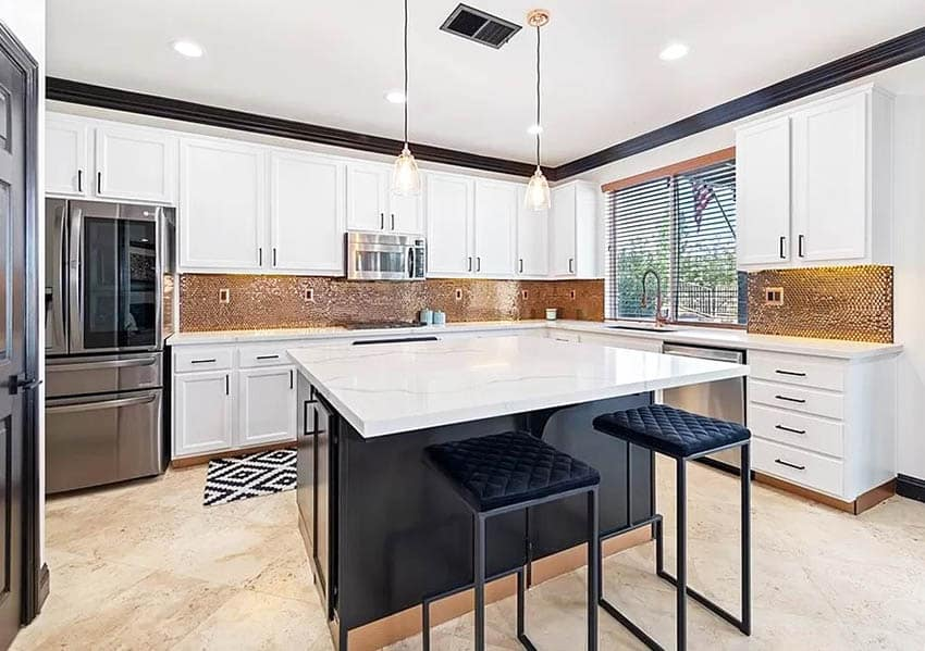 Kitchen with copper mosaic backsplash white cabinets calacatta quartz countertops travertine flooring