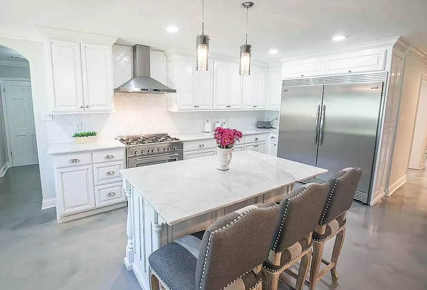Kitchen with gray epoxy floors white cabinets marble countertops
