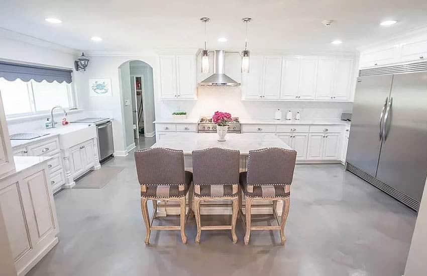 Kitchen with gray metallic epoxy floors white cabinets