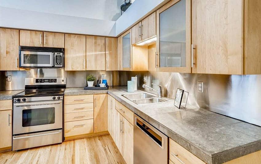 Kitchen with sheet metal backsplash