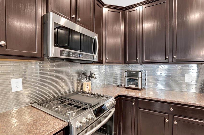 Kitchen with horizontal stainless steel backsplash