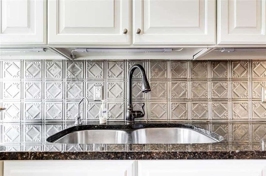 Kitchen with tin backsplash behind sink