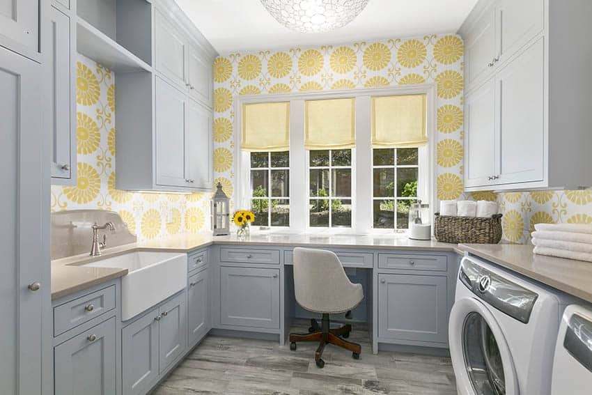 Laundry craft room with built-in desk and cabinets