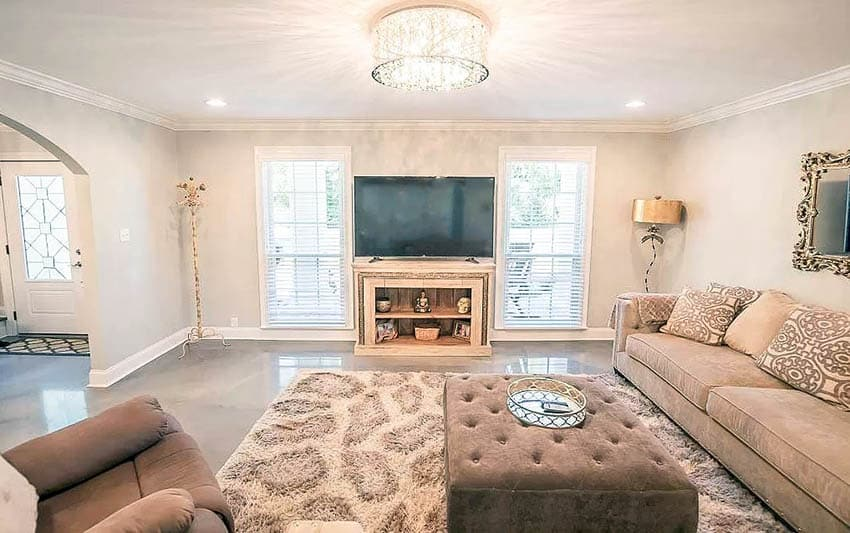 Living room with polished gray epoxy flooring