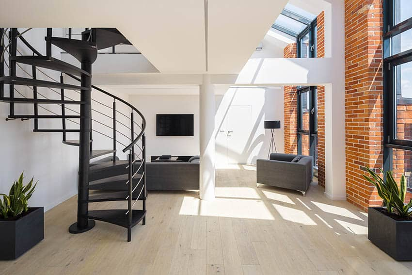Loft with metal circular floating stairs