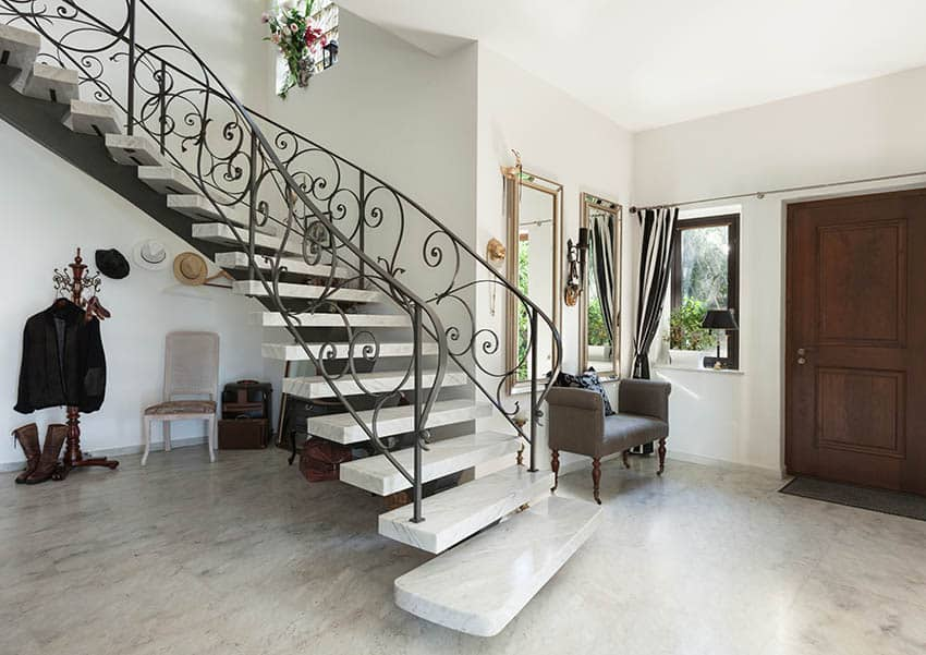 Marble floating stairs with wrought iron hand railing