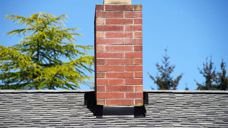 Masonry chimney on house