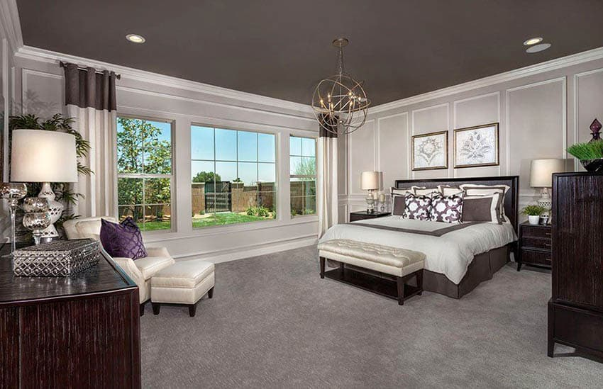 Master bedroom with king size bed and brown accent ceiling