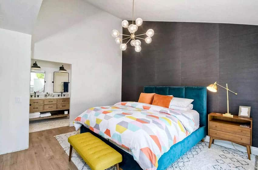Master bedroom with king sized bed and black accent wall