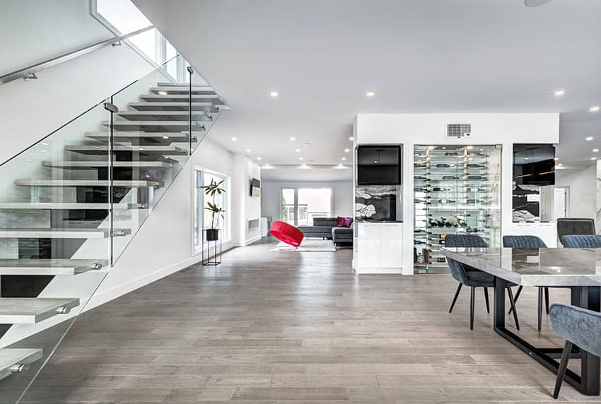 Modern concrete floating stairs in living room with wine closet