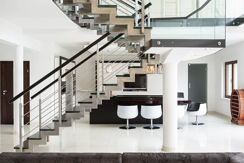 Modern floating stairs with stainless tension wires and black hand rails