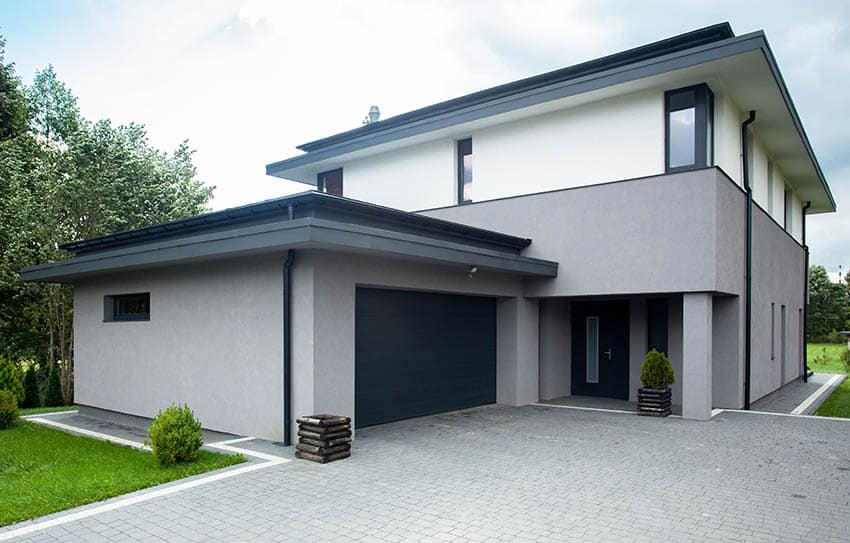 Modern house with gray stucco and smooth finish exterior