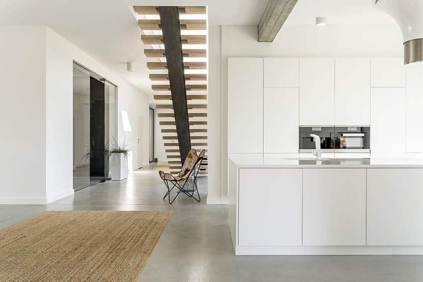 Modern kitchen next to floating staircase