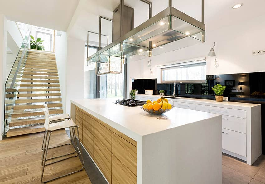 Modern kitchen with floating stairs glass railing