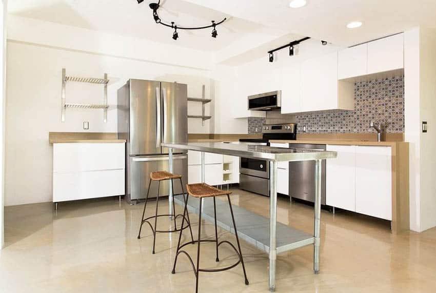 Modern kitchen with metallic epoxy floor white cabinets