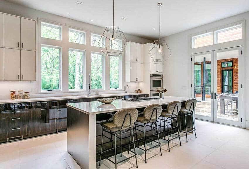 Modern kitchen with two tone cabinets porcelain tile flooring pendant lighting
