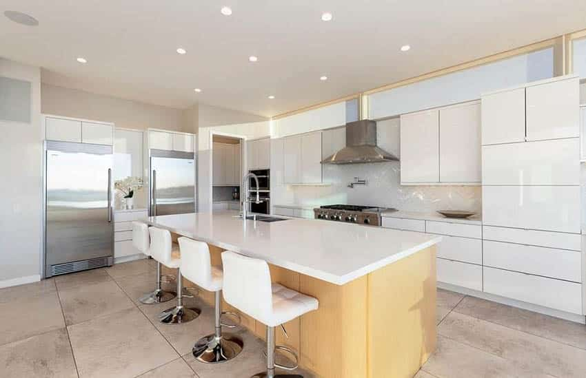 Modern kitchen with white cabinets large tile flooring light color wood island