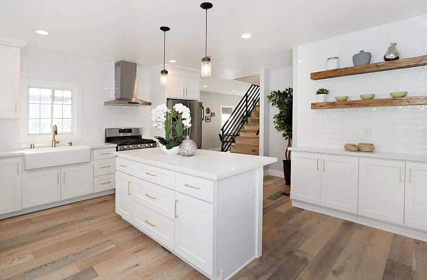 Renovated bungalow kitchen with white cabinets gold hardware