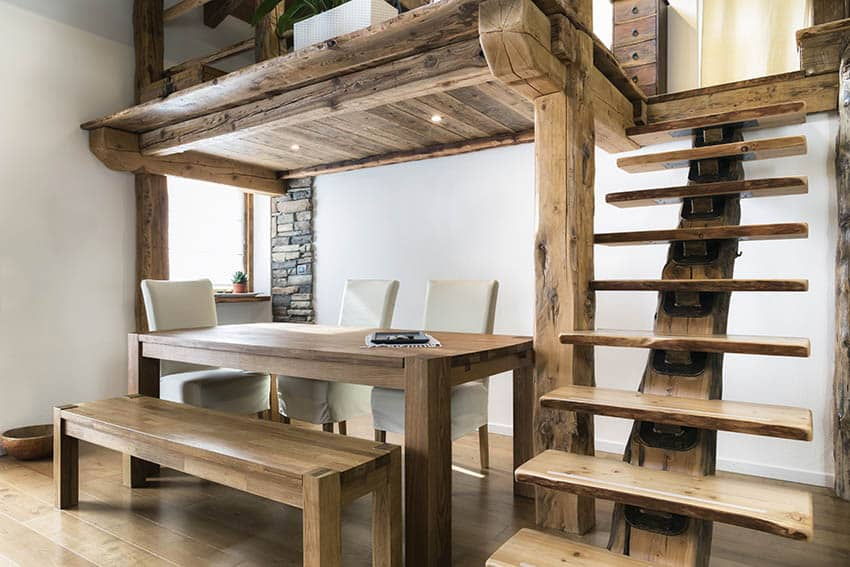 Rustic floating wood stairs to loft