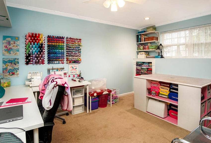 Sewing room with island storage corner desk