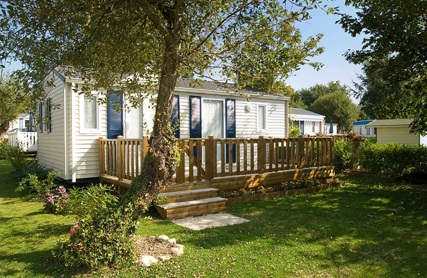 Small manufactured house with white siding