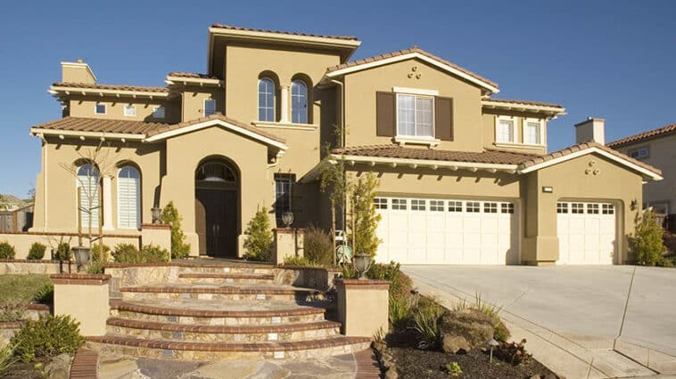 Stucco house exterior in front yard