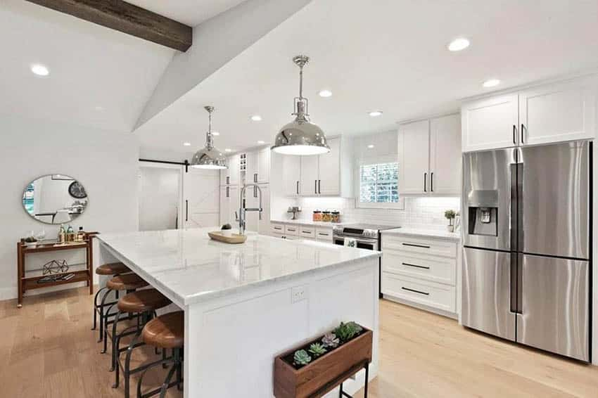 White cabinet kitchen with light color hardwood flooring