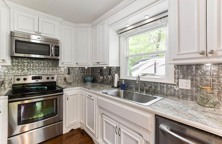 White kitchen with tin backsplash