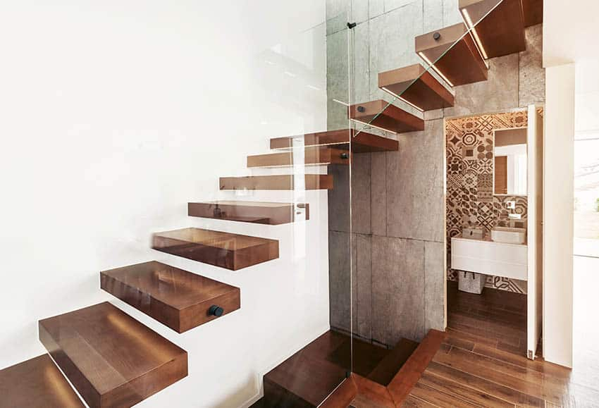 Wood floating stairs with glass railing