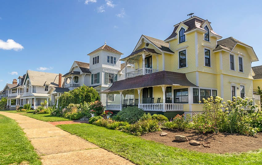Colorful shingle style house with front porch