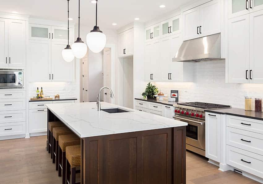 Contemporary kitchen island with touchless faucet across from stove