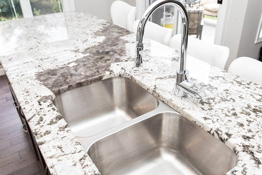 Double basin sink with granite countertops