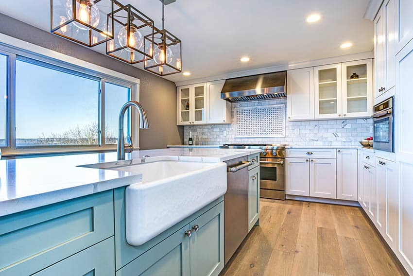 Kitchen with single basin farmhouse style apron sink in island