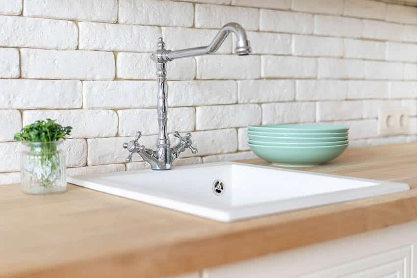 Kitchen with single bowl sink and faucet