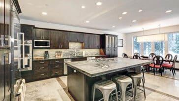 Kitchen with sintered stone countertops dark wood cabinets