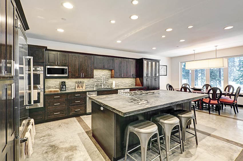 Kitchen with sintered stone countertops dark wood cabinets