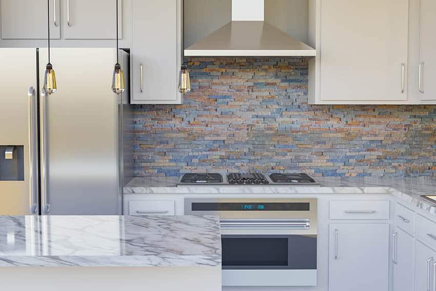 Kitchen with stone veneer backsplash white cabinets