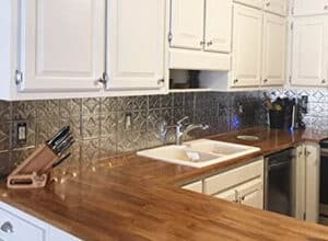 Kitchen with tin ceiling tile backsplash