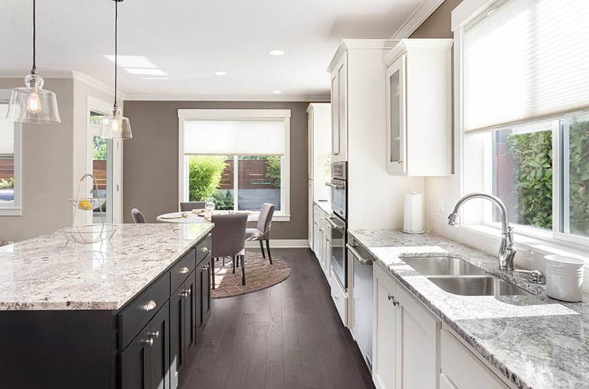 Kitchen with touch faucet and white cabinets