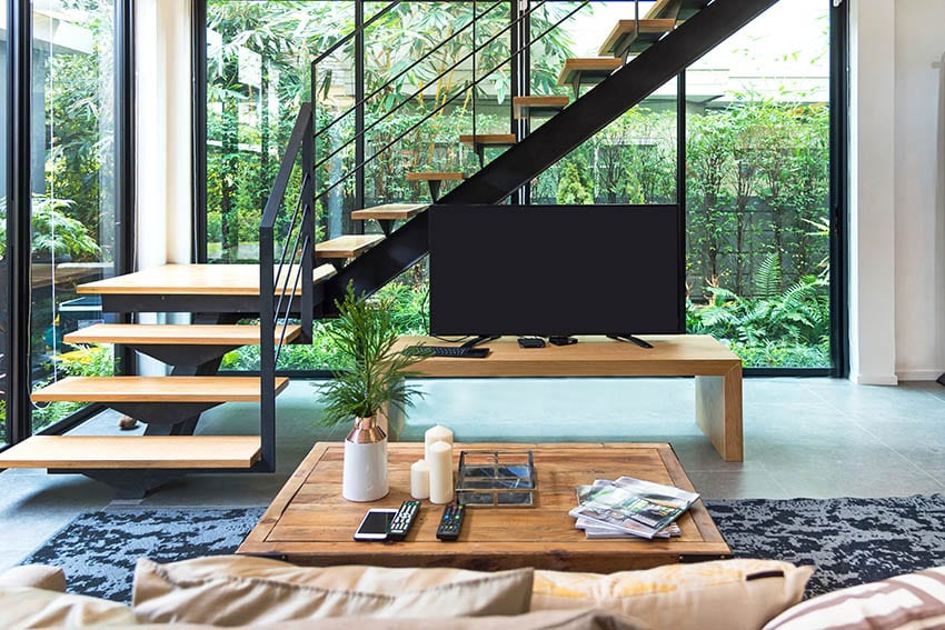 Light beechwood Scandinavian style floating stairs to open concept living room kitchen