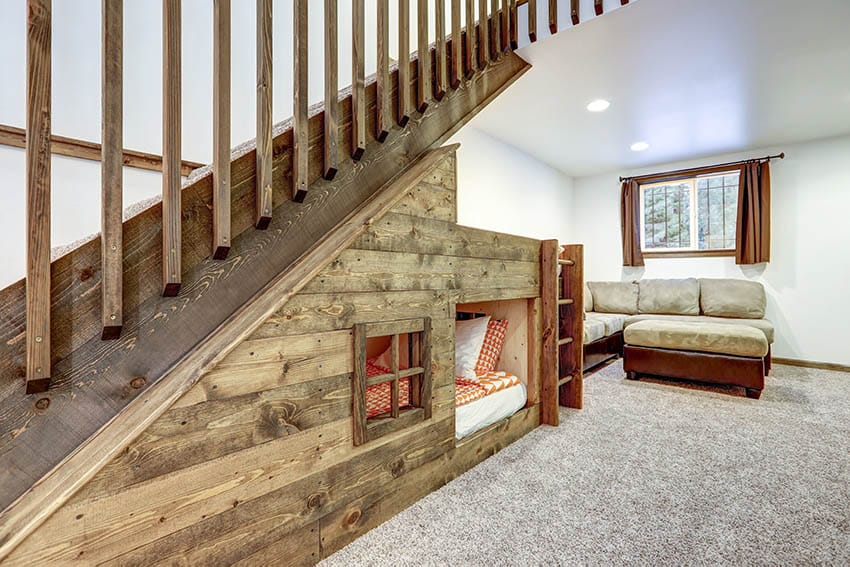 Living room stair case with custom bed niche