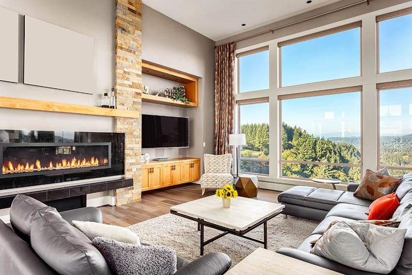 Living room with modern electric fireplace and floating wood mantel