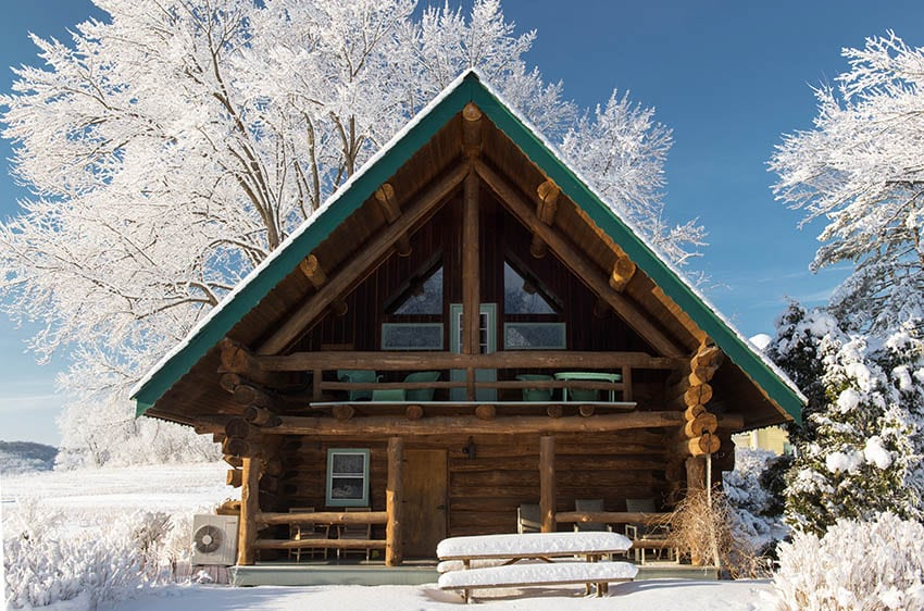 Log cabin with snow